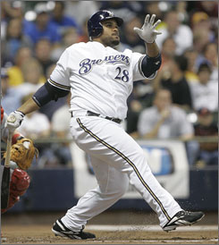 Prince Fielder unloads the first of two home runs on Tuesday. This one came in the first inning against St. Louis before his second in the seventh made him the youngest, at 23, to hit 50.