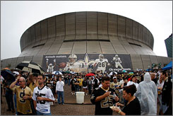 Fans tailgate before Monday Night Football outside the Superdome, home of the New Orleans Saints and the Sugar Bowl in January.