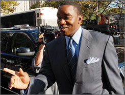 New York Knicks coach Isiah Thomas arrives at court Tuesday.