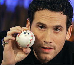 Marc Ecko holds No. 756, which he will send to the Baseball Hall of Fame with an asterisk attached. Barry Bonds hit the ball that placed him ahead of Henry Aaron on the home run list.