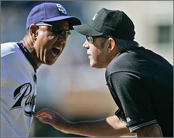 "San Diego Padres first base coach Bobby Meacham argues with umpire Mike Winters after Winters ejected outfielder Milton Bradley in last Sunday's game. Meacham called Winters' remarks toward Bradley ""the most unprofessional and most ridiculous thing I've ever seen."""