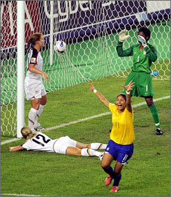 Brazil's Cristiane, foreground, celebrates after U.S. midfielder Leslie Osborne (12) deflected the ball into Team USA's goal as keeper Brianna Scurry (1) and midfielder Lori Chalupny, left, look on during their 4-0 semifinal loss Thursday in the Women's World Cup.