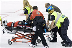 Ottawa's Dean McAmmond is wheeled off the ice after taking a hit from Philadelphia's Steve Downie earlier this week. Downie was suspended for 20 games by the NHL on Friday.