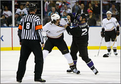 After dropping their gloves, the Ducks' George Parros, left, and Scott Thornton of the Kings square off on the ice during Anaheim's 4-1 victory in London.