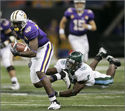 Brandon LaFell, left, and LSU escaped the glut of top 10 upsets Saturday, defeating Tulane 34-9 in New Orleans and jumping USC into the top spot in the AP poll while staying pat at No. 2 in the USA TODAY coaches' poll.