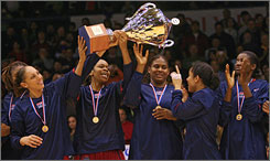 The U.S. women's national team flashes its hardware after winning the gold medal in the FIBA Olympic qualifier.