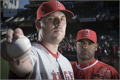 Los Angeles pitchers John Lackey, left, and Kelvim Escobar combined for 37 wins while leading the Angels to a postseason appearance against the Boston Red Sox.