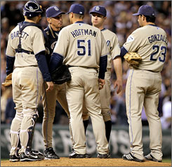 Padres manager Bud Black makes a 13th-inning visit to the mound to talk with pitcher Trevor Hoffman, catcher Michael Barrett and first baseman Adrian Gonzalez. Moments later, Jamey Carroll's sacrifice fly scored Matt Holiday with the Rockies' winning run, and Hoffman, baseball's all-time saves leader with 524, had blown one of his biggest saves ever.