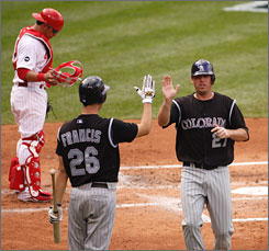 Garrett Atkins, right, got the Rockies on the scoreboard first with an RBI double in the second inning and pitcher Jeff Francis helped make the early lead stand up as Colorado took the opening game of their best-of-five division series with the Philadelphia Phillies.