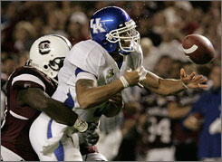 Kentucky quarterback Andre Woodson lost two fumbles, including this one in the first quarter, that were returned for touchdowns by Gamecocks DE Eric Norwood (not pictured).