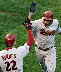 Chris Young, right, and Eric Byrnes provided the offensive punch as the Diamondbacks advanced to the NL Championship Series with a sweep of the Chicago Cubs. Young hit a home run to lead off the game and Byrnes added a solo shot in the sixth.