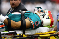 Dolphins quarterback Trent Green left the field on a stretcher after sustaining a concussion.