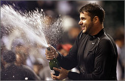Colorado's Jason Hirsh sprays champagne after the Rockies swept the Philadelphia Phillies in the NLDS on Saturday.