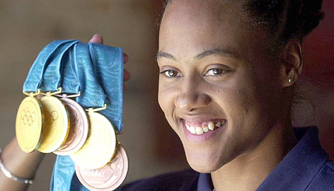 A then-happy Marion Jones won three gold medals and two bronze medals at the 2000 Summer Olympics. But they are no longer hers after she admitted last week to doping.