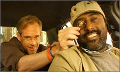 Fox announcer Joe Buck, left, may end up hailing a cab from new on-air partner Abebe in a potential late-night show.