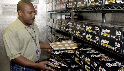 Rockies engineer Tony Cowell checks out baseballs in Coors Field's humidor in 2002. The idea for adding moisture to balls bubbled up when Cowell noticed that his leather boots had constricted in the summer, making him think about the leather covering on baseballs and Denver's dry air.