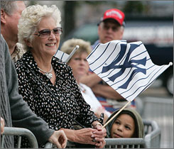 Yankees fan Gari Ann Truscott of Pebble Beach, Calif., waits outside Yankee Stadium in hopes of getting an autograph as the players returned to the stadium Tuesday to pack up their equipment for the offseason.