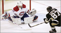 Montreal's Carey Price stopped 26 Pittsburgh shots, including this one on Pittsburgh superstar Sydney Crosby, in his NHL debut.