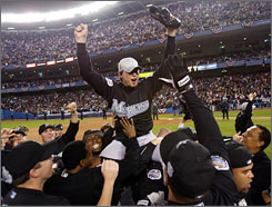Josh Beckett and his teammates celebrate the Marlins' 2003 World Series championship. Beckett pitched a shutout in the deciding Game 6 against the Yankees.