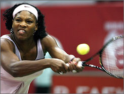 Serena Williams hits a return against Nicole Vaidisova during her quarterfinal match at the Kremlin Cup.