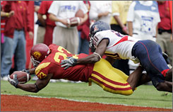 Southern California's Chauncey Washington scored the first touchdown for the Trojans by beating Arizona's Cameron Nelson to the end zone.