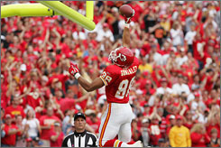 Tony Gonzalez celebrates his first touchdown on Sunday -- it was the 63rd of his career and gave him the record for most touchdowns by a tight end.