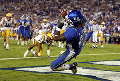 Kentucky's Steve Johnson hauled in the game-winning touchdown pass in the third overtime of the Wildcats' upset win over then-No. 1 LSU on Saturday.