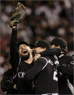 Todd Helton celebrates with his Rockies teammates after Colorado clinched its first World Series berth with the NLCS sweep of the Diamondbacks.