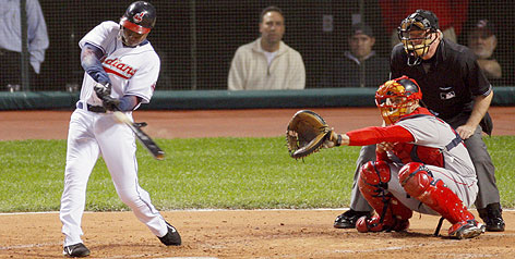 Kenny Lofton's two-run homer in the last of the second inning sent the Indians to a 4-2 victory over the Red Sox in Game 3 of the ALCS. Cleveland is up 2-1 heading to Game 4 on Tuesday, also at Jacobs Field. Umpire Brian Gorman and Sox catcher Jason Varitek watch bat and ball collide.