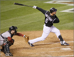 NLCS Most Valuable Player Matt Holliday cracks a three-run homer to climax a six-run fourth inning for the Rockies in Game 4 of the NLCS vs. Arizona. Chris Snyder, who later homered for the D'backs, is behind the plate.