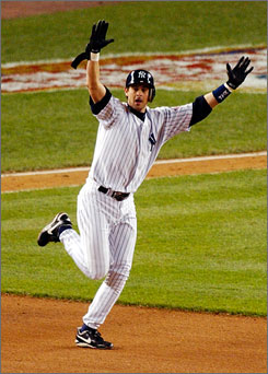 The Yankees' Aaron Boone celebrates his game-winning home run off Red Sox pitcher Tim Wakefield in the 11th inning of Game 7 of the 2003 ALCS.