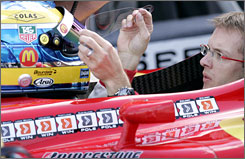 Sebastien Bourdais, here adjusting his helmet before qualfiying in Holland, has five Champ Car victories this season.