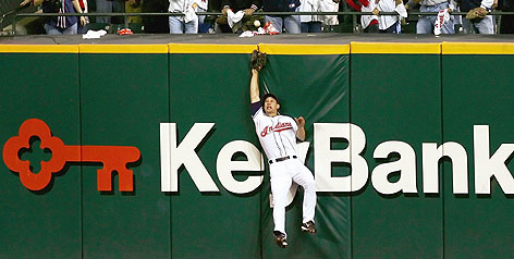 Grady Sizemore leaps for Manny Ramirez's drive in the third inning at Jacobs Field. The ball bounded back onto the field for an RBI single.