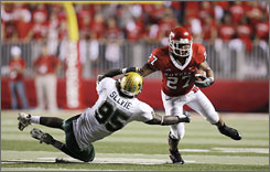 Rutgers running back Ray Rice rushed for 181 yards to help power the Scarlet Knights past George Selvie and South Florida.