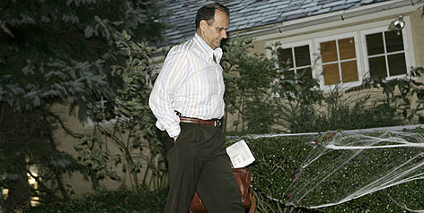Joe Torre returns to his suburban New York City home after cutting ties with Yankees.