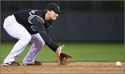 Troy Tulowitzki fields a grounder during the NLCS against the Diamondbacks. The Rockies rookie has a date with the Boston Red Sox in the World Series starting Wednesday.