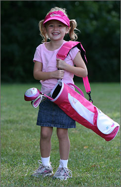 Eva McCrehin, 4, is set to play with Barbie golf clubs, which debut next month. The 3-club set, designed for girls 4-6, includes a carrying bag, ball and visor.
