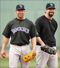 Rockies special assistant Walt Weiss, right, and first baseman Todd Helton have a laugh during the club's Tuesday workout at Fenway Park.