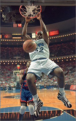 Shaquille O'Neal, shown dunking in front of Knicks great Patrick Ewing in March 1996, made the Magic and Heat's all-time five but missed out on the Lakers.