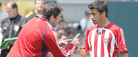 Chivas USA coach Preki, left, gives instruction to Paulo Nagamura. Preki led the team to a 15-7-8 regular-season record this year. Two years ago, Chivas went 4-22-6.