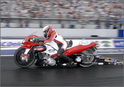 Peggy Llewellyn won her first NHRA Pro Stock Motorcycle race in September, breaking a drag-racing barrier in the process.