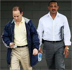 Yankees' general manager Brian Cashman and first base coach Tony Pena in Tampa, Fla. after Pena was interviewed for the team's vacant managerial job.