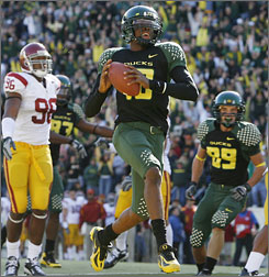 Oregon QB Dennis Dixon prances into the end zone for a first-quarter touchdown during the fifth-ranked Ducks' 24-17 triumph over No. 8 Southern California.
