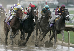 War Pass, right, breaks away out of the final turn to win the Breeders' Cup Juvenile by 4 1/2 lengths.