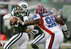The Bills' Larry Tripplett chases down Jets quarterback Chad Pennington after he scrambled out of the pocket during first-half action in New York. Pennington was eventually replaced by Kellen Clemens in the fourth quarter, but it didn't help as Buffalo emerged with a 13-3 victory.