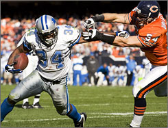 "The Lions' Kevin Jones fends off the Bears' Brian Urlacher on a second-half scamper during Detroit's victory at Soldier Field. ""He's a bull in a china shop,"" Lions center Dominic Raiola says of Jones."