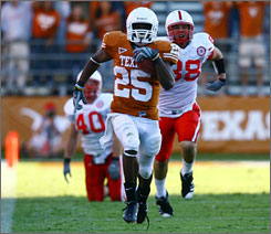 Texas running back Jamaal Charles breaks free for one of his three fourth-quarter touchdown runs against Nebraska.
