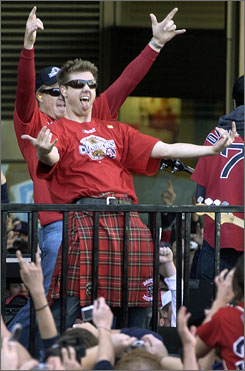 Jonathan Papelbon and his teammates dance in front of fans during the Red Sox's victory parade in Boston on Tuesday.
