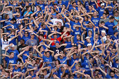 Kansas administrators are trying to combat a profane kickoff chant by telling students to regulate themselves.