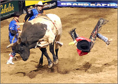 Justin McBride, seen here flying off Genex Stormy during a ride on Sept. 21, hopes to hold on after an unspectacular start at the PBR World Finals in Las Vegas.